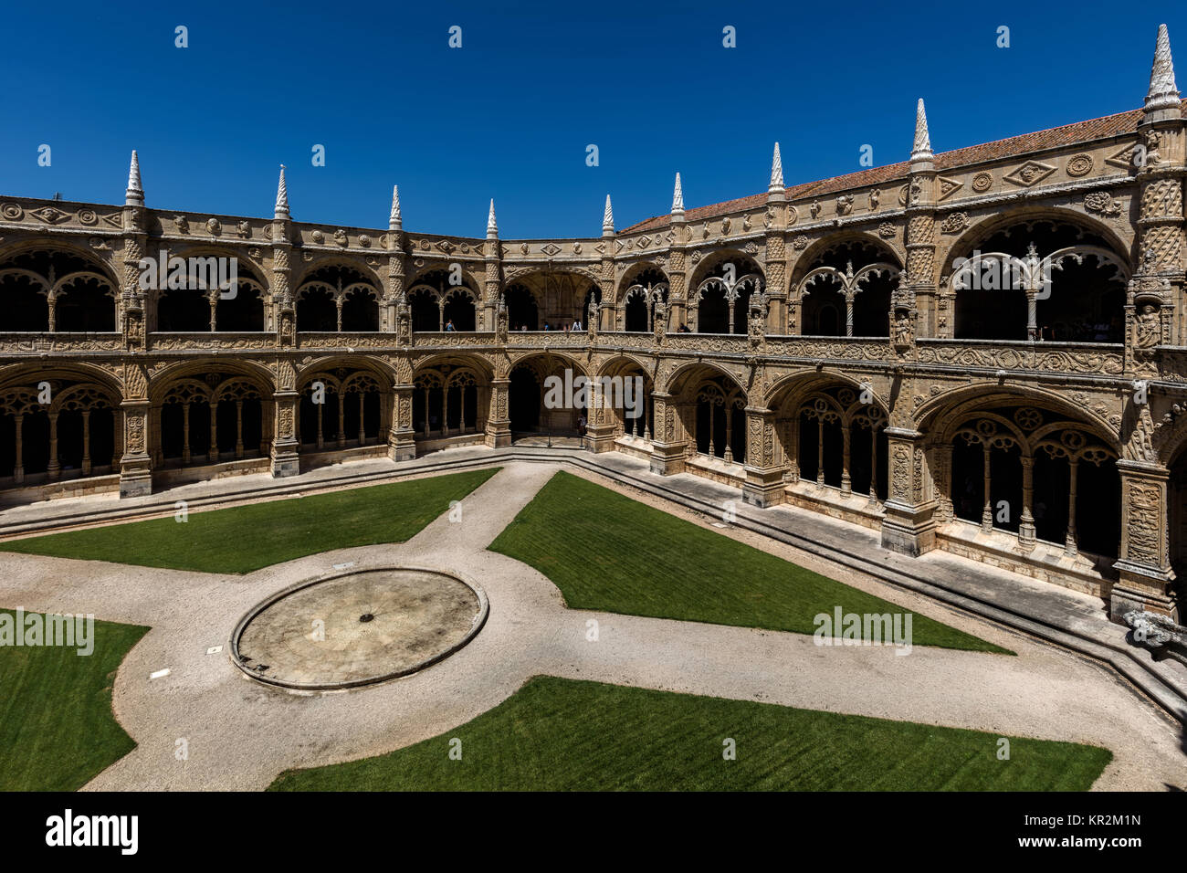 Two-storey cloisters of the Jeronimos Monastery. The monastery is one of the most prominent examples of the Portuguese - Stock Image