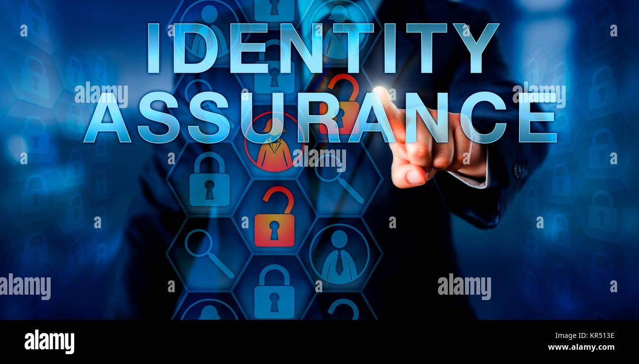 Administrator Pressing IDENTITY ASSURANCE - Stock Image