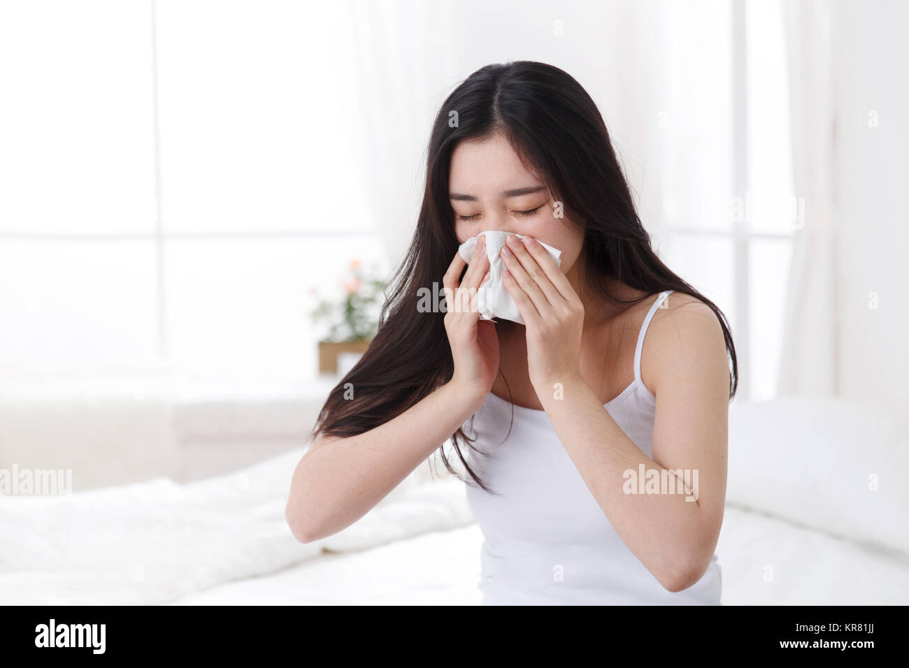 Young women are catching cold - Stock Image