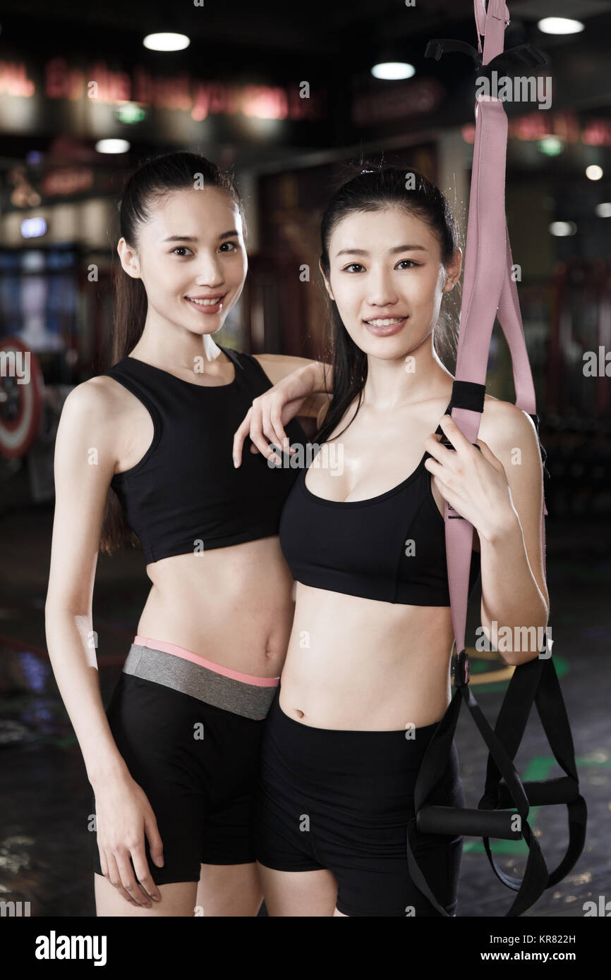 Young women at the gym - Stock Image