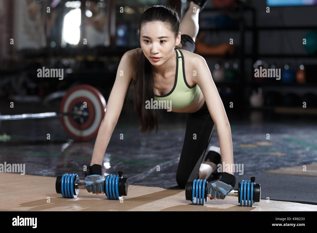 Young women exercise at the gym - Stock Image
