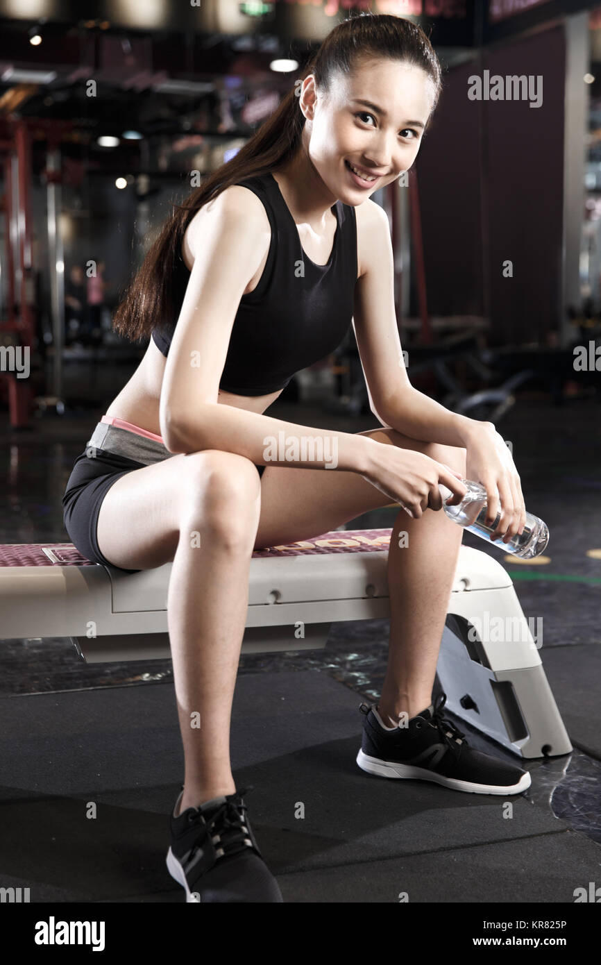 Young women rest at the gym - Stock Image