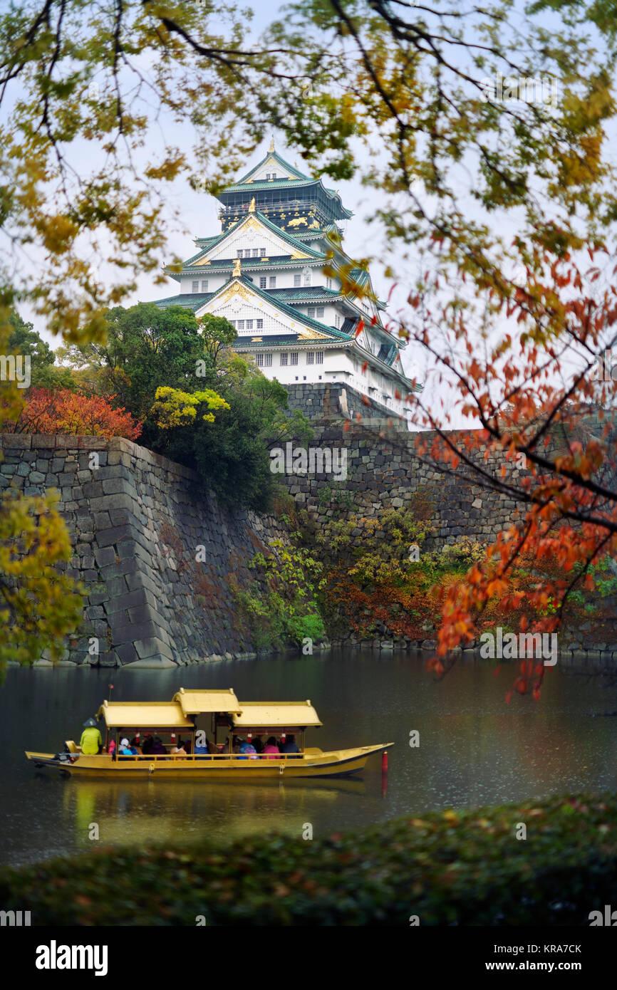 Osaka Castle, Osakajo and people taking a ride on Osaka-jo Gozabune Boat in Osaka Castle inner moat canal. Osaka - Stock Image