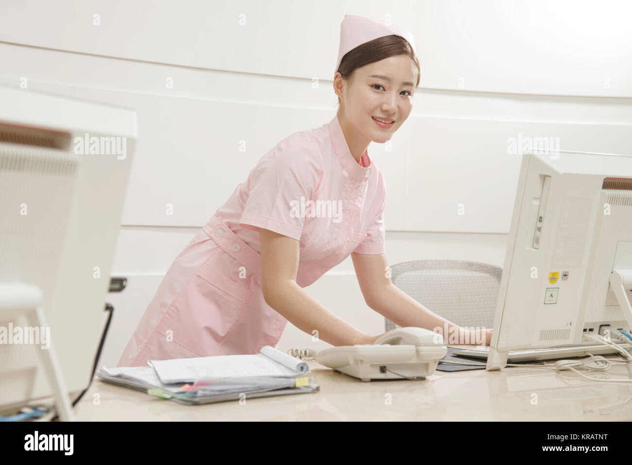 Young women nurses are using computers - Stock Image