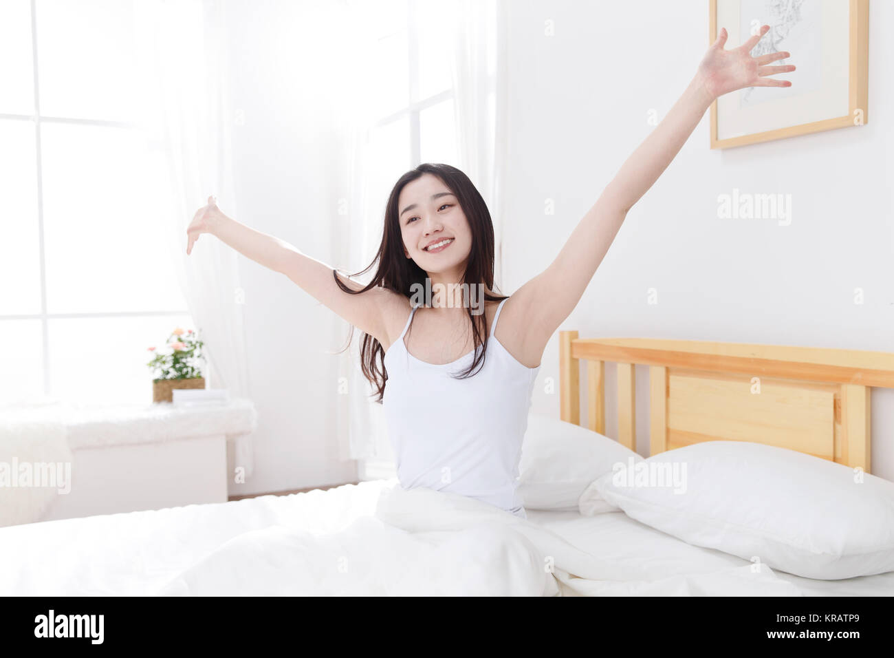 Young women get up - Stock Image