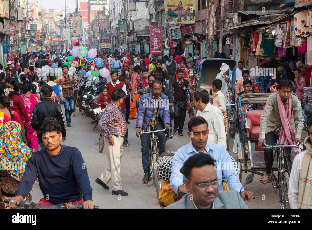Traffic and pedestrians in a busy and congested Dasashwamedha Ghat Road in Varanasi, Uttar Pradesh, India - Stock Image