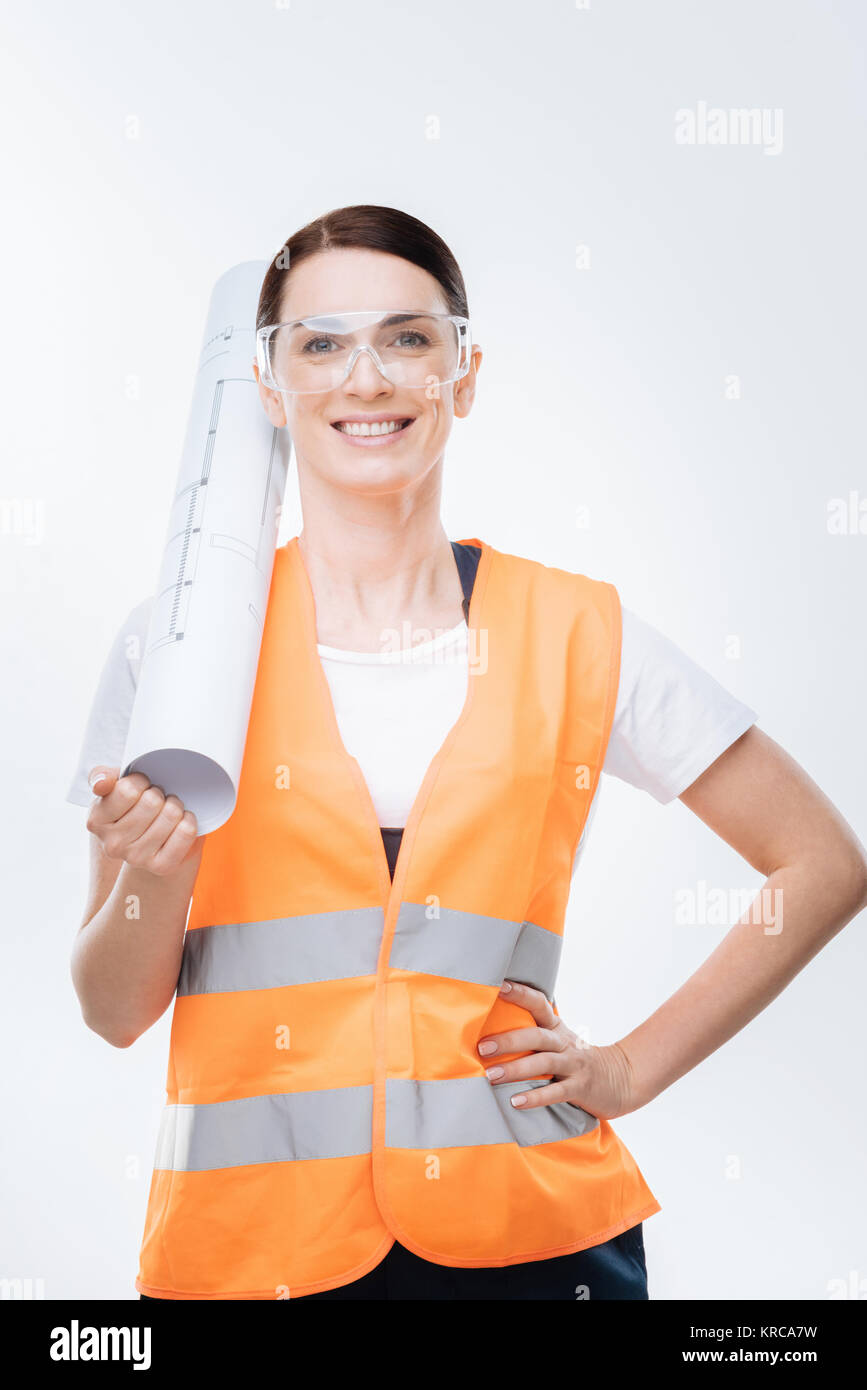 Happy female  engineer  estimating plan - Stock Image