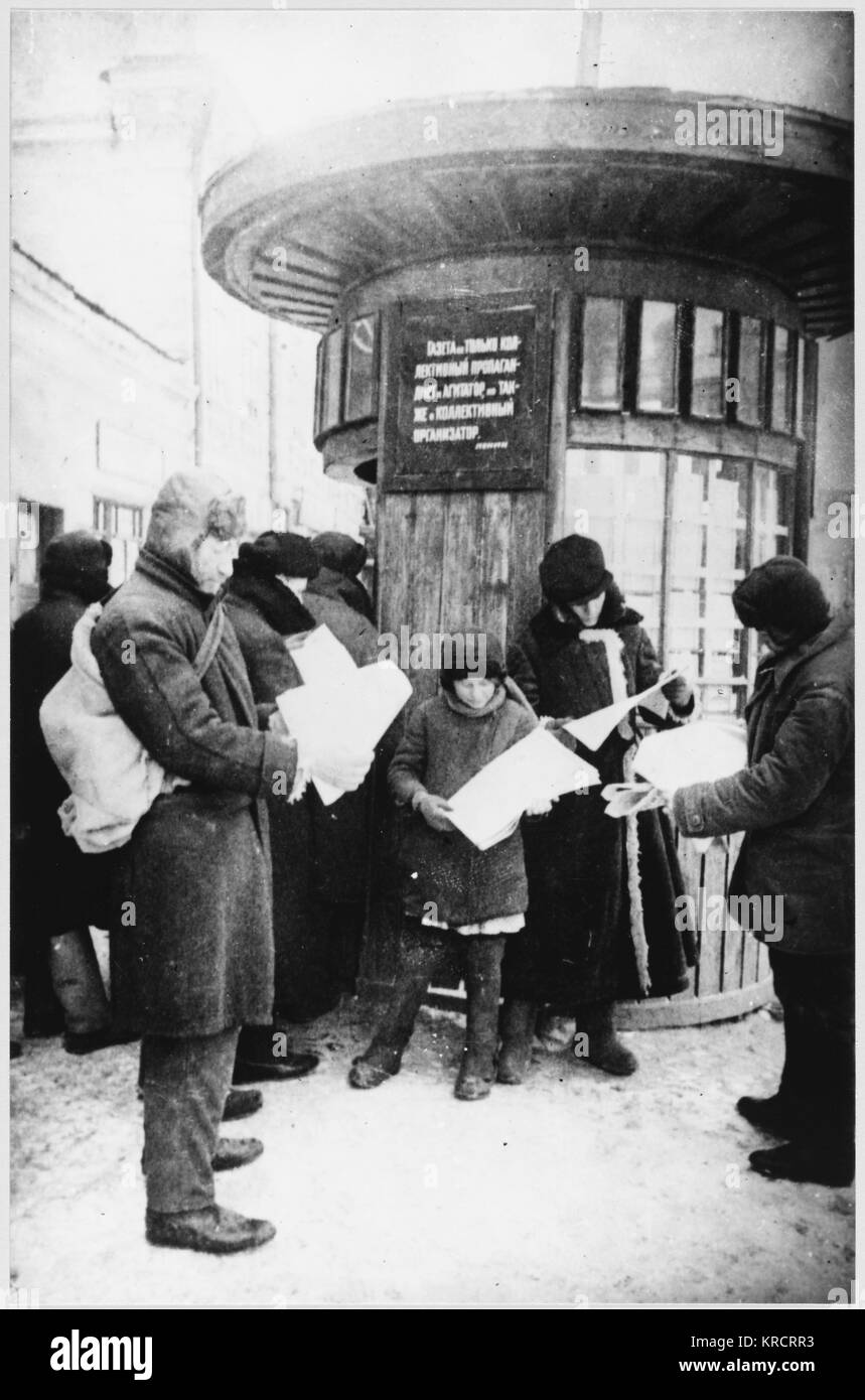 Muscovites, with the Germans on the outskirts of their city, read the latest news about the battle for Moscow. Date: - Stock Image