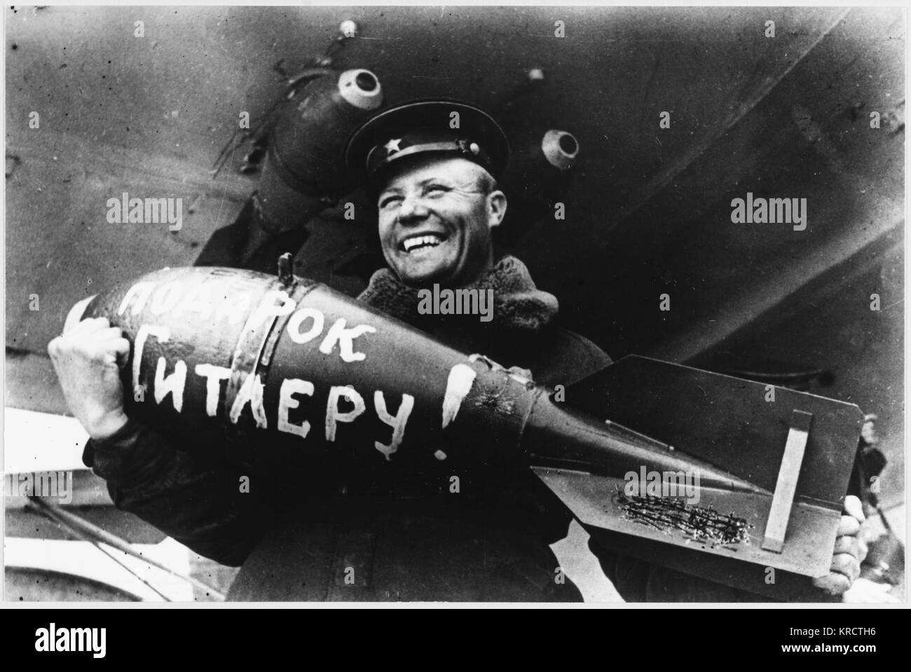 Loading a bomb inscribed 'a present for Hitler'. - Stock Image