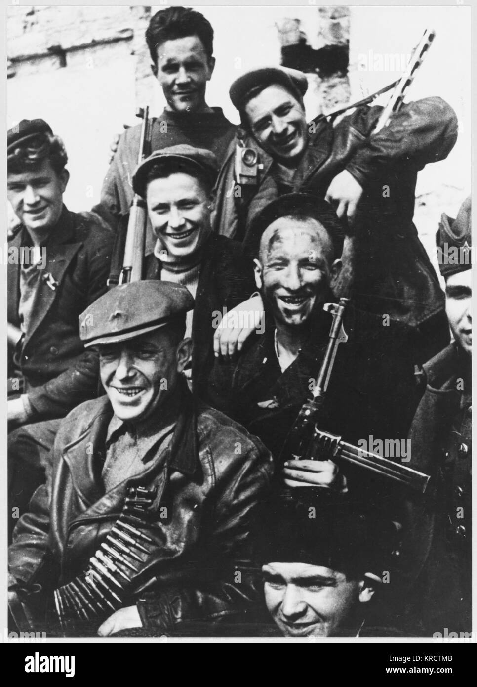 A group of cheerful Soviet Partisans at Odessa, on the Black Sea coast of Ukraine. - Stock Image