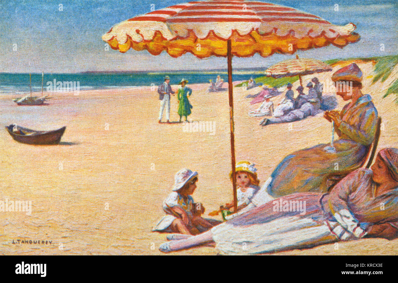 Shaded from the sun beneath a beach-parasol on the sand. Date: 1920s - Stock Image