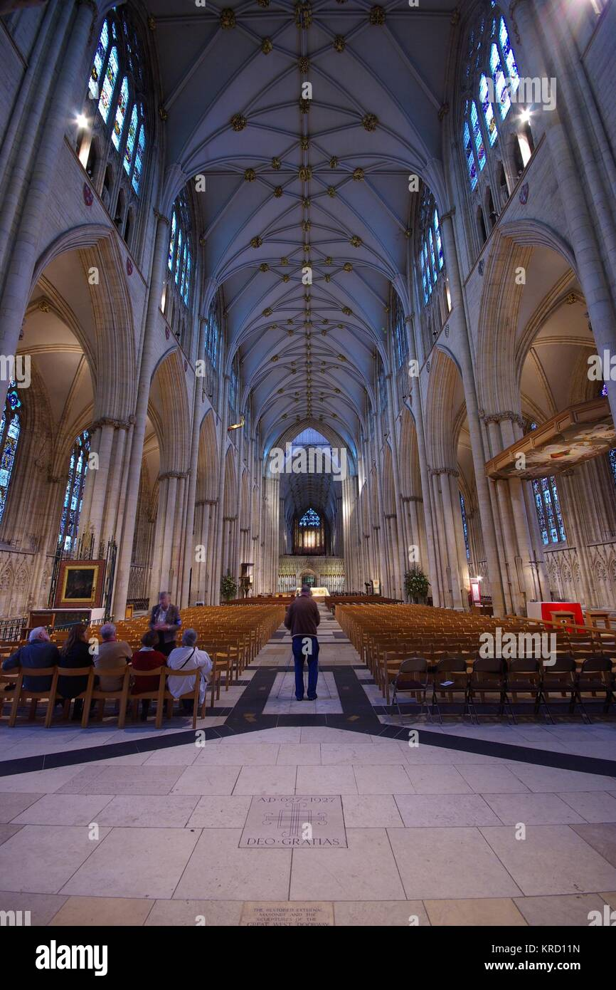 View of the interior of York Minster, showing the vaulted ceiling and stained glass windows to full advantage.  - Stock Image