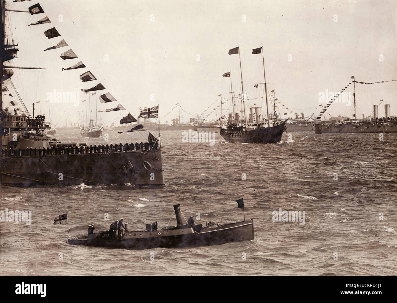 King George V reviewing the British naval fleet at Spithead, Hampshire.  The Fleet Review is a British tradition, - Stock Image