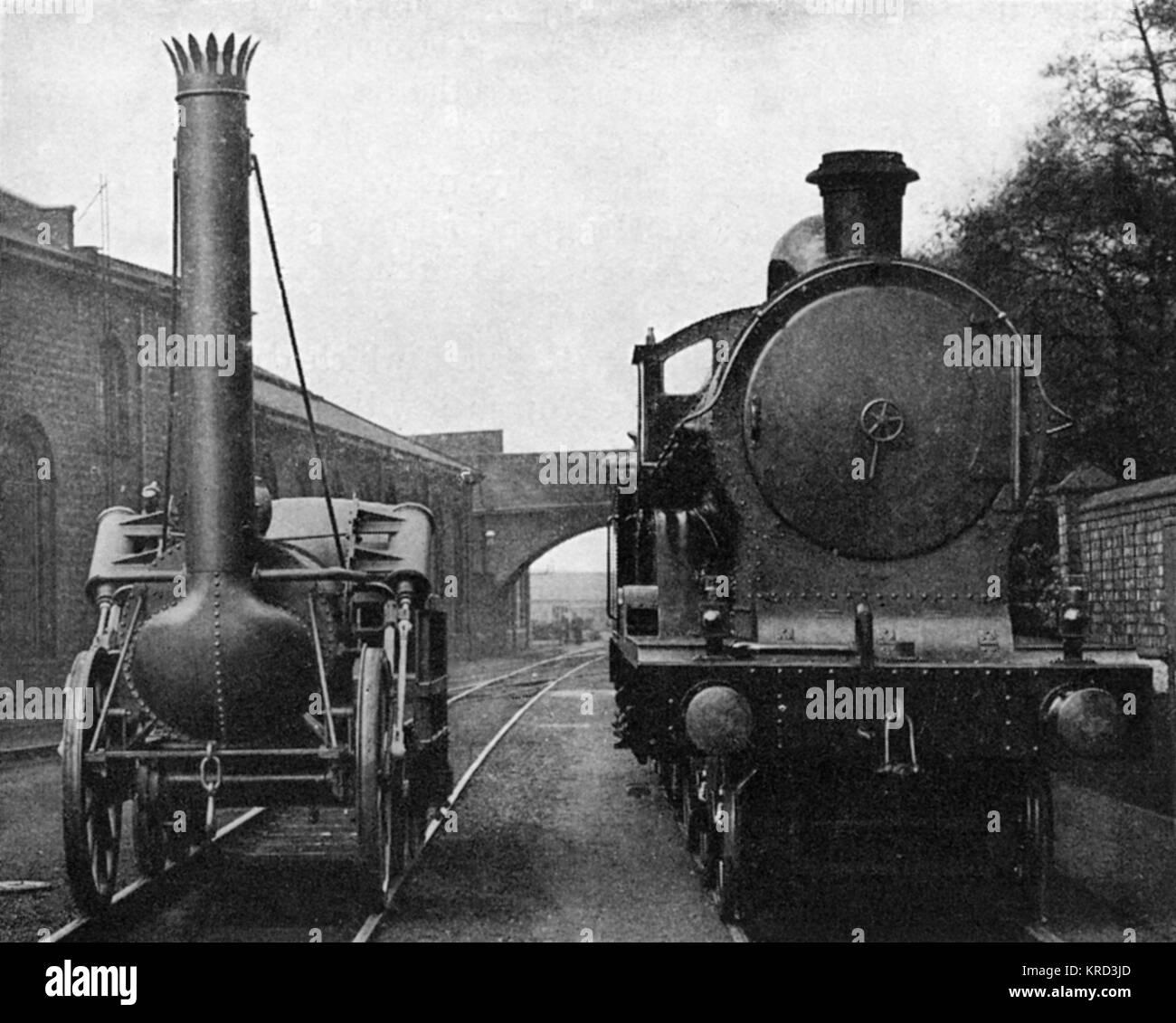 An interesting comparison: a full sized model of Stephenson's Rocket(originally built in 1829), alongside an - Stock Image