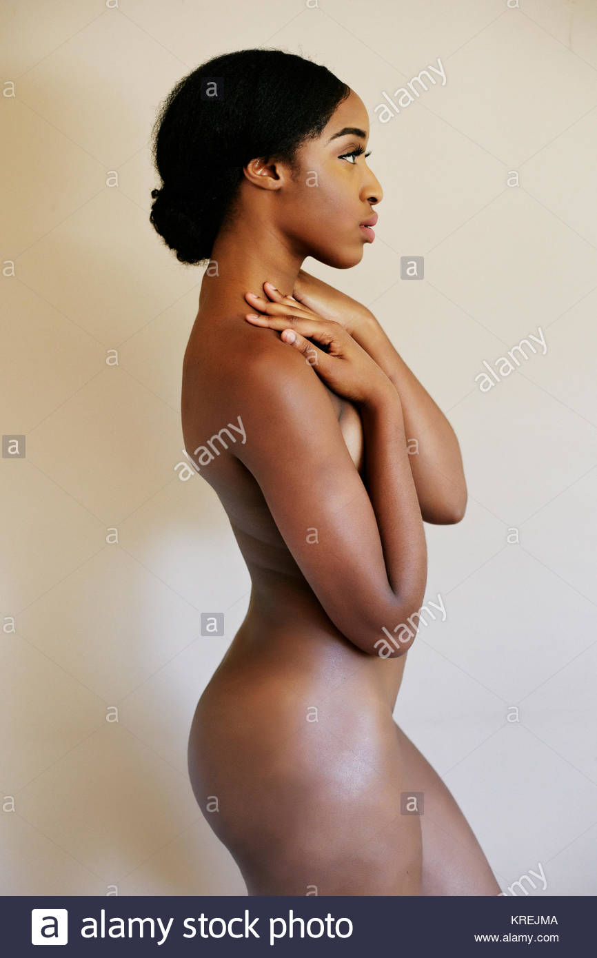 Profile of naked mixed race woman - Stock Image