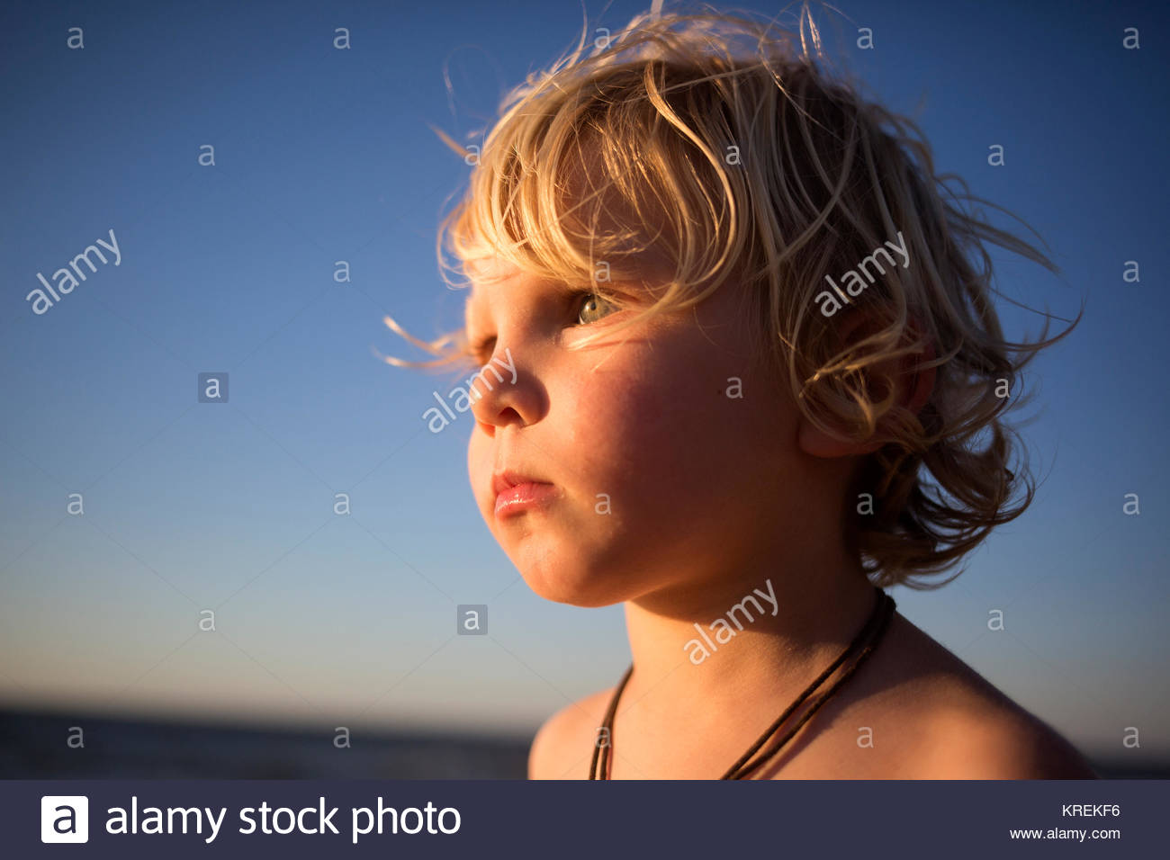 Close up of serious Caucasian boy - Stock Image