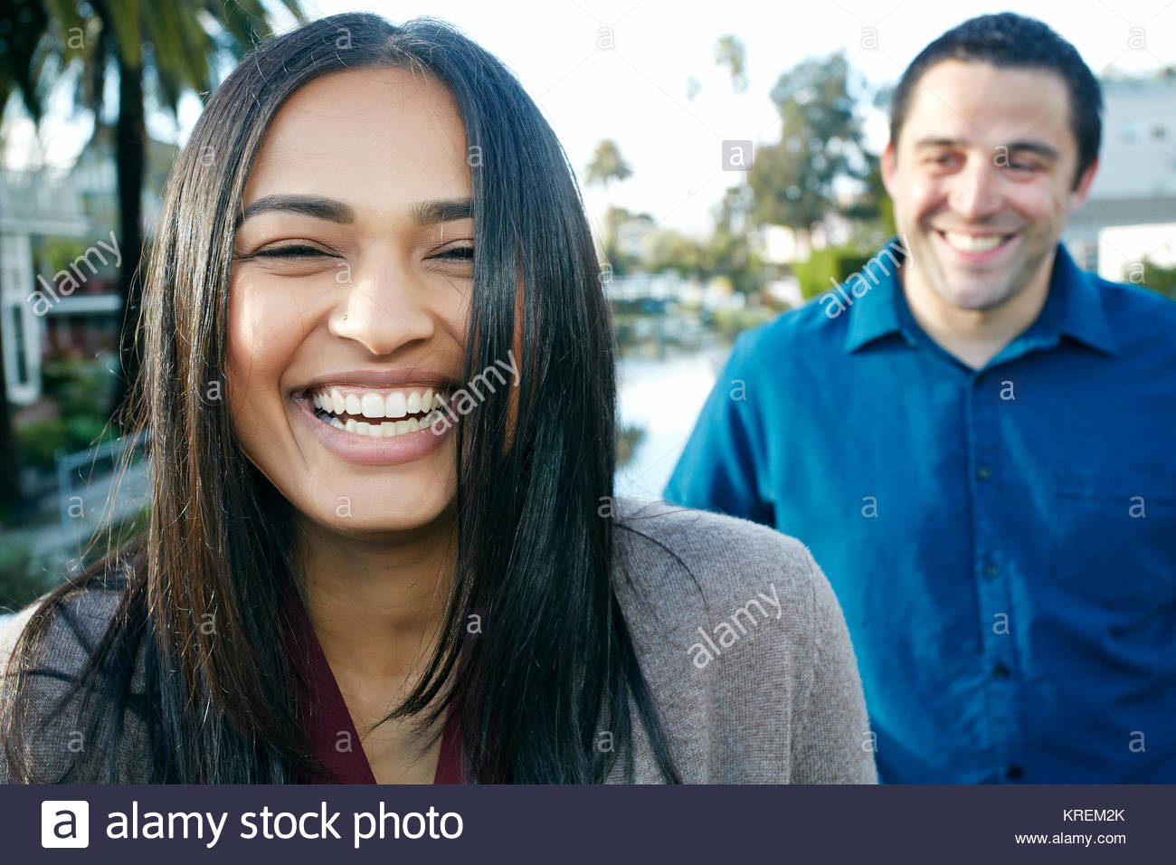 Close up of laughing couple - Stock Image