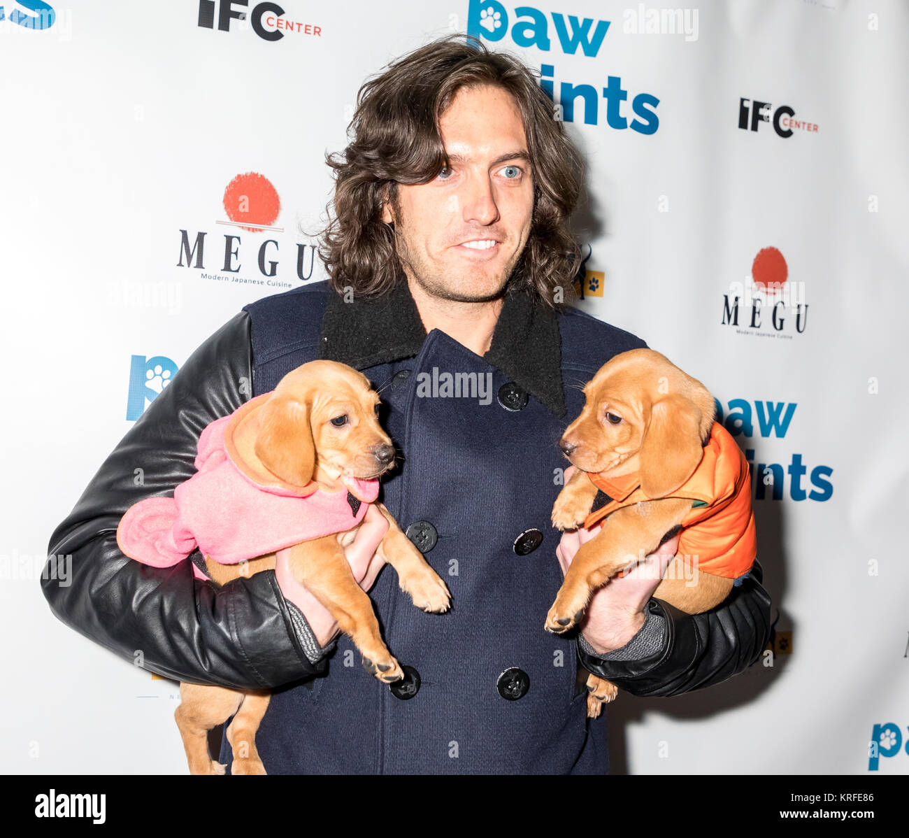New York, NY, USA - December 19: Andrew Jenks with adoptable dogs attends Paw Prints 1st Annual Paw-liday party Stock Photo