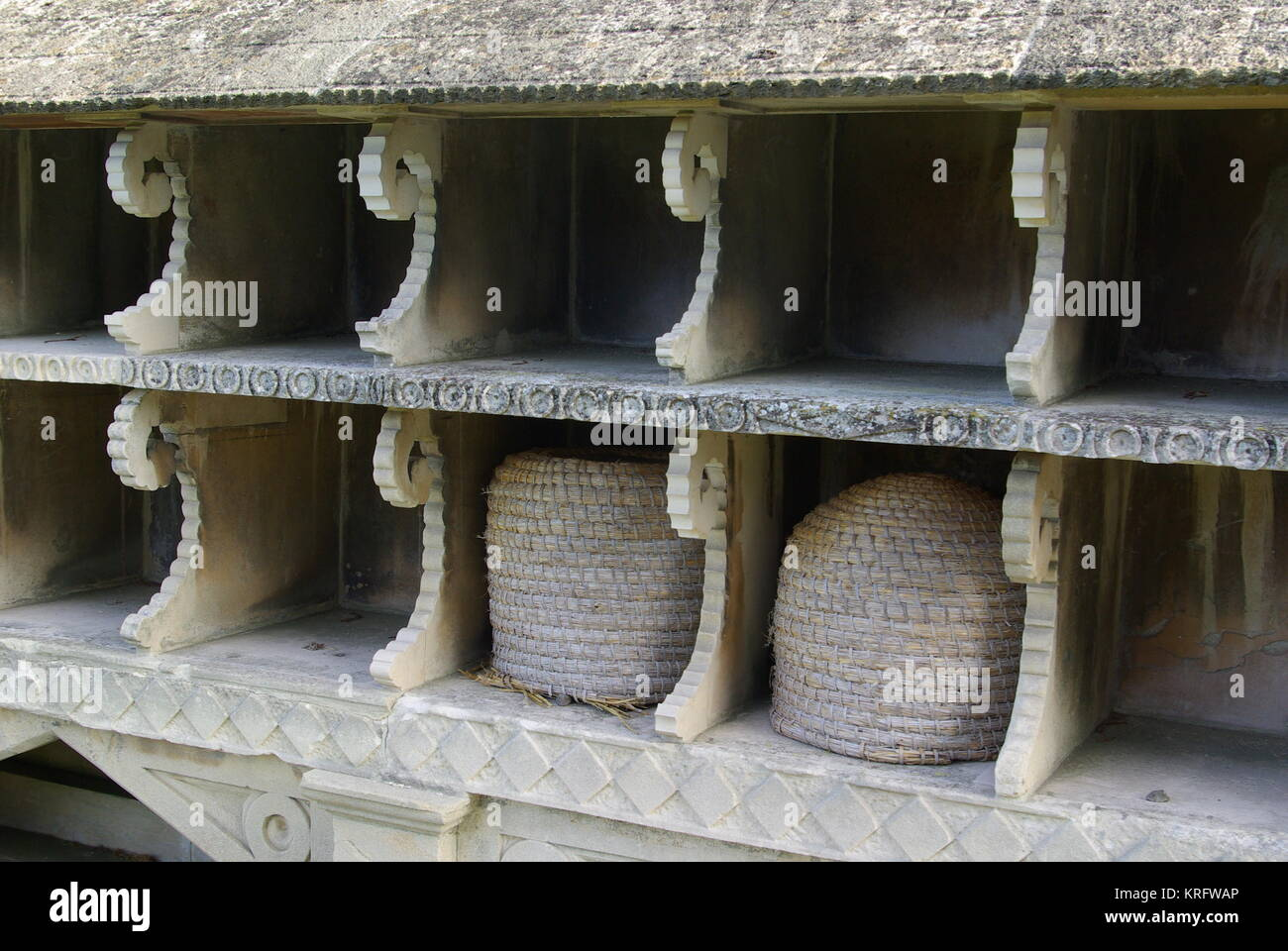 Close-up of a bee shelter or beehive rack dating from the mid-19th century in the churchyard of St Mary's Church, - Stock Image