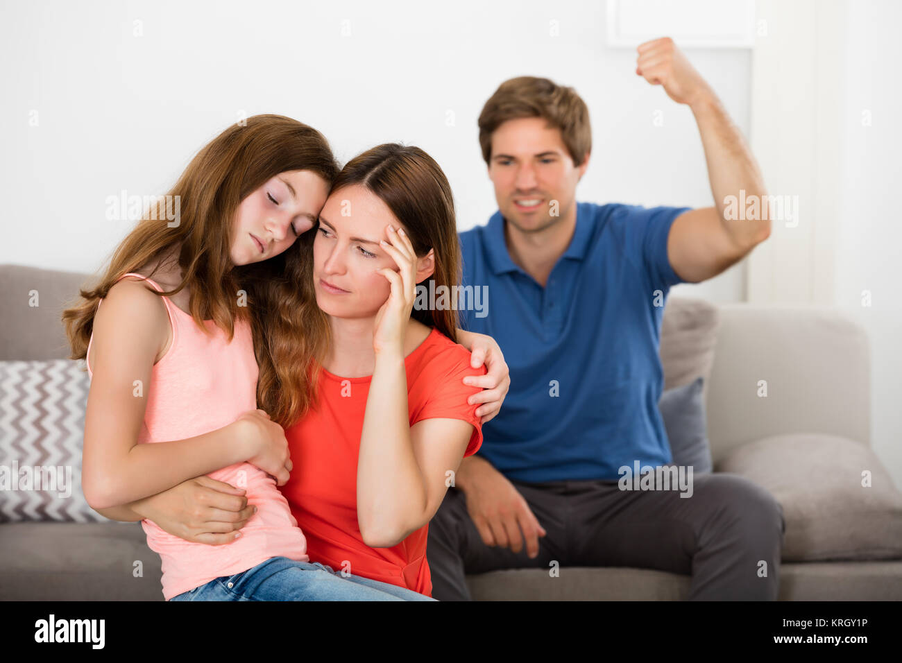 Mother And Daughter Depressed With Violent Father - Stock Image