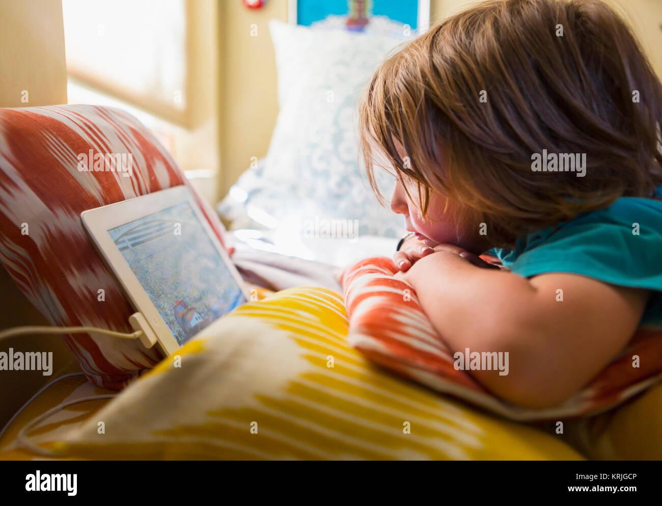 Caucasian boy watching digital tablet - Stock Image