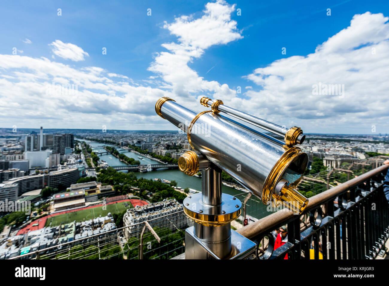 Telescope at scenic view of river in city, Paris, Ile de France, France - Stock Image