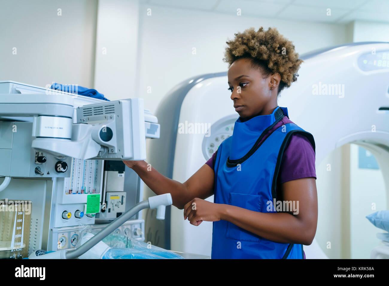 Black hospital technician wearing protective vest - Stock Image