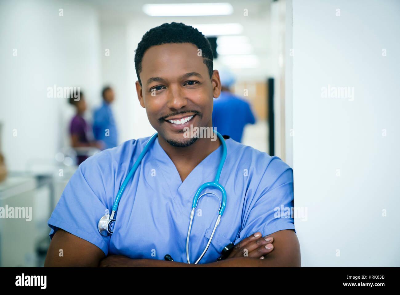 Portrait of smiling black nurse - Stock Image