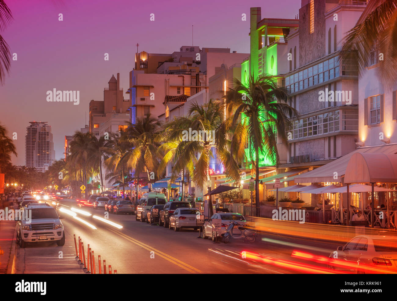 Cars driving in street at night, Miami Beach, Florida, United States - Stock Image