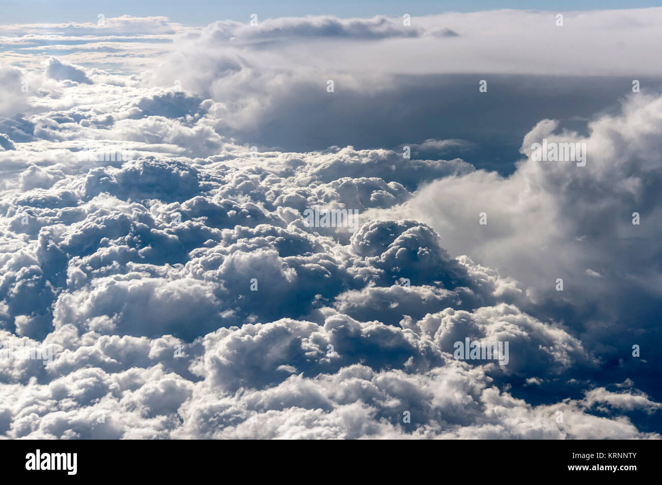 Aerial View of a wide  bank of fluffy white clouds Clouds - Stock Image