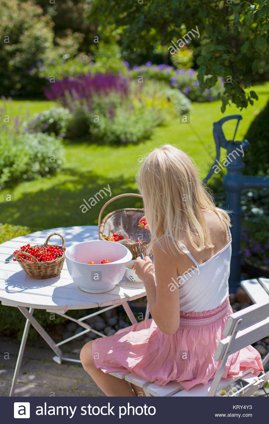 Girl cutting berries - Stock Image