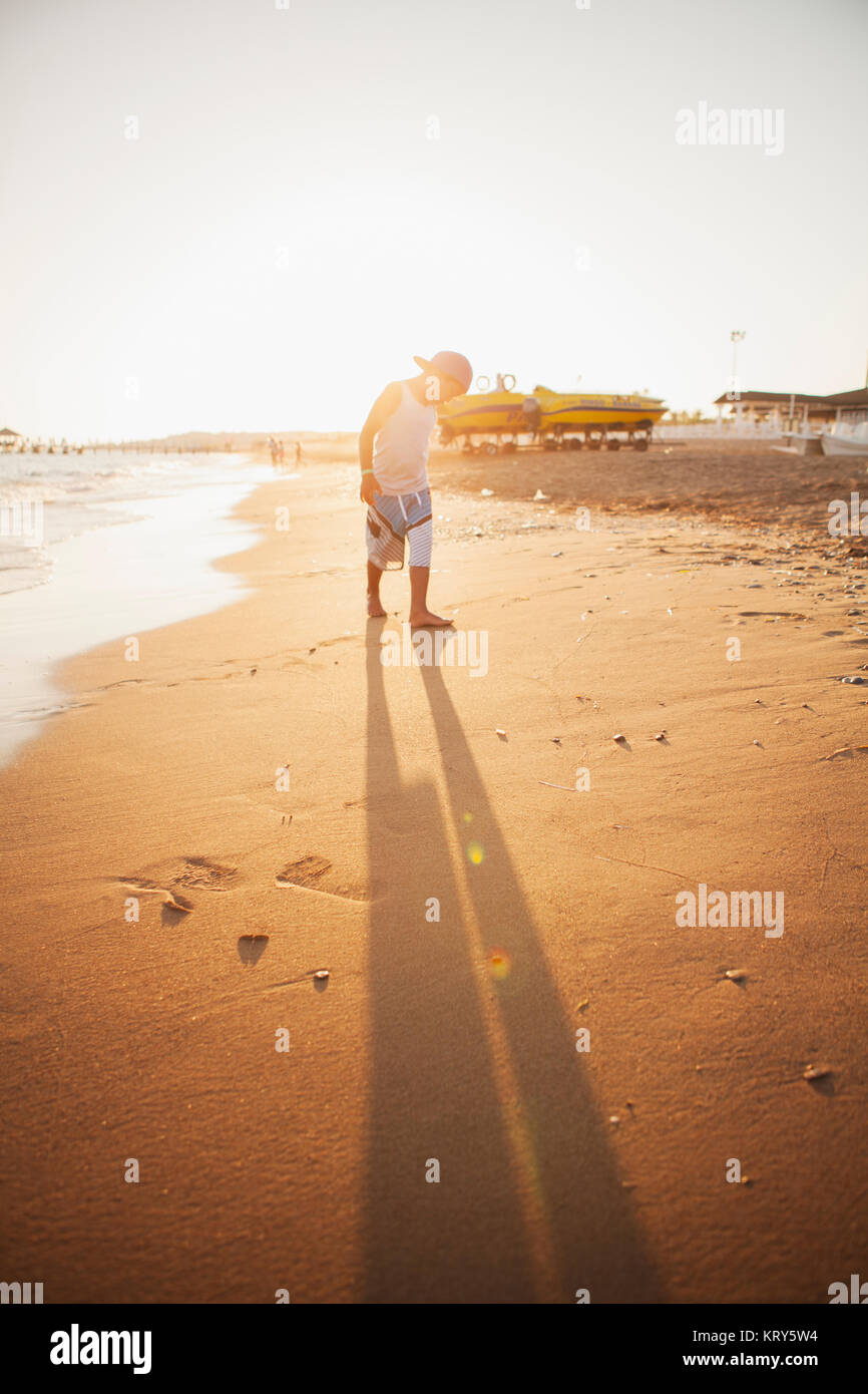 A boy on the beach in Turkey - Stock Image