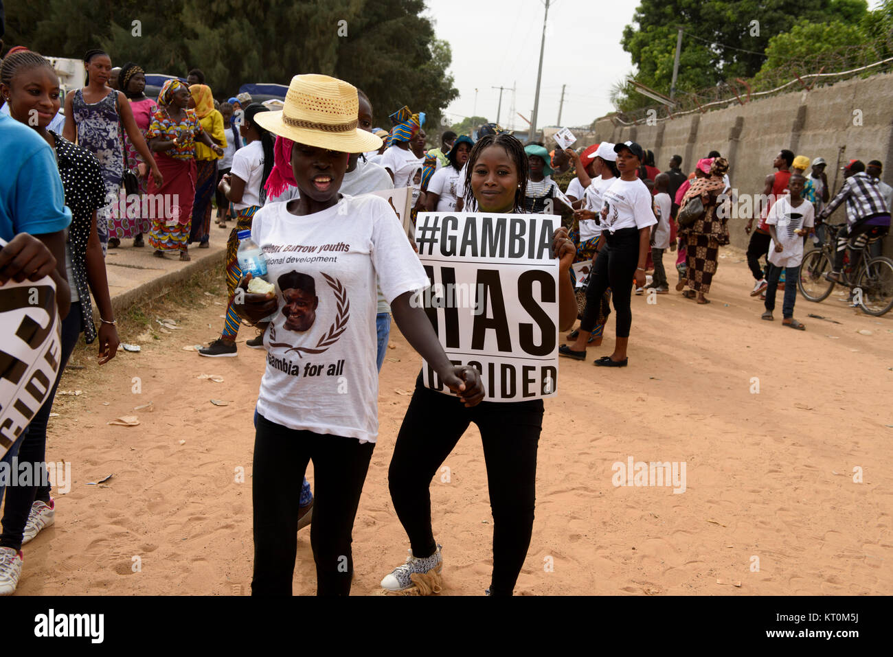 President Adama Barrow is popular among the young Gambians. The girl is holding a placard reading: #Gambia Has Decided - Stock Image
