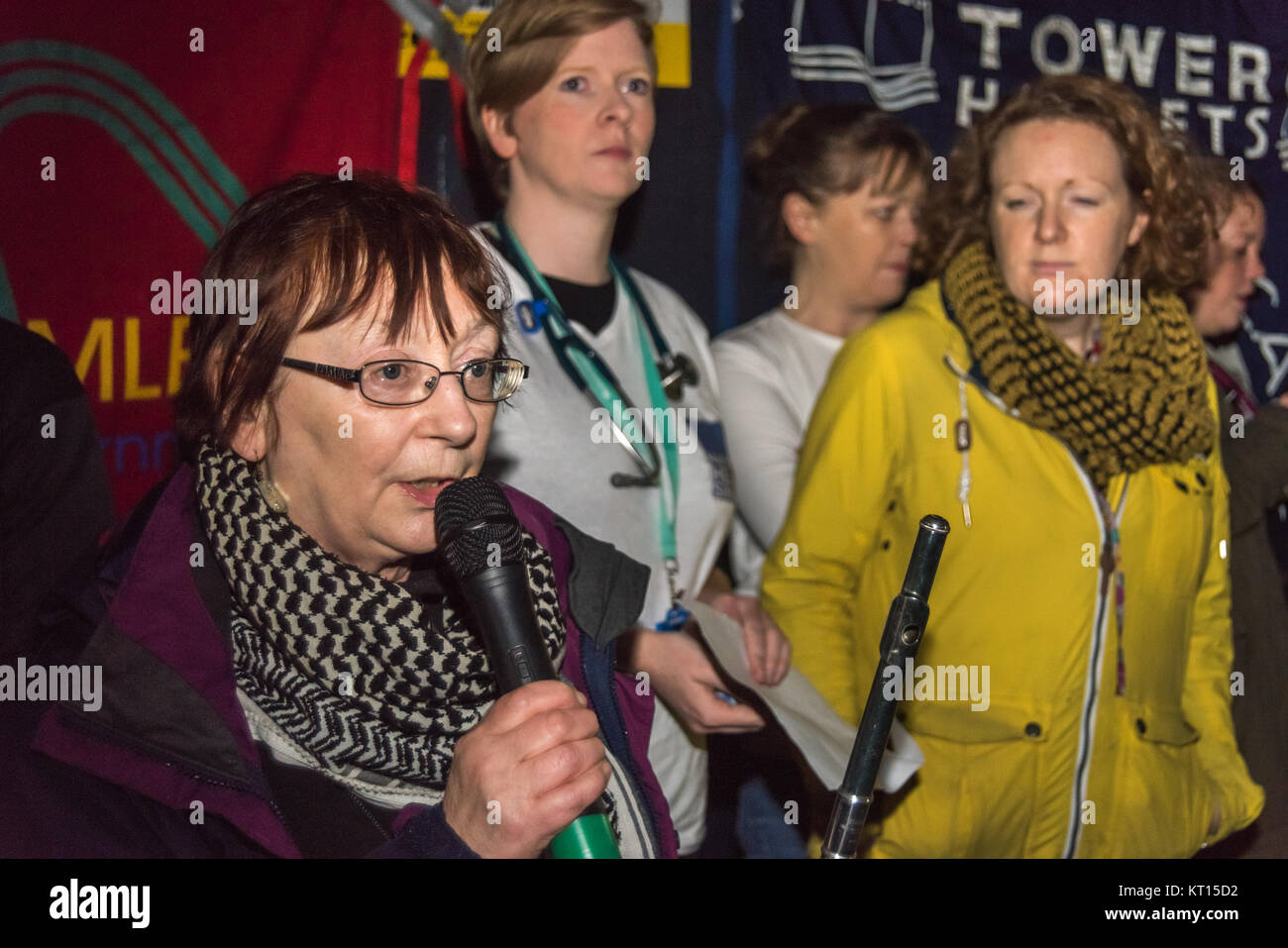 Maggie Falshaw, one of the organisers of the 'Save Our Surgeries' campaign speaks at the Christmas protest - Stock Image