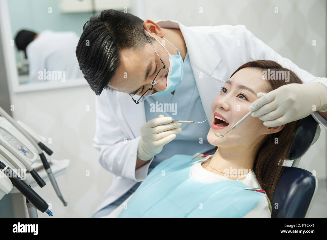Male dentists and female patients - Stock Image