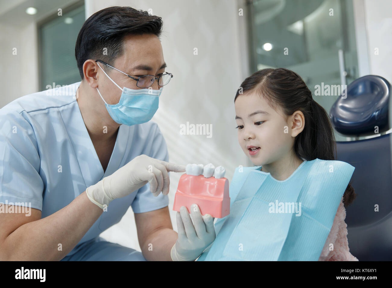 Cute little girl and dentist - Stock Image