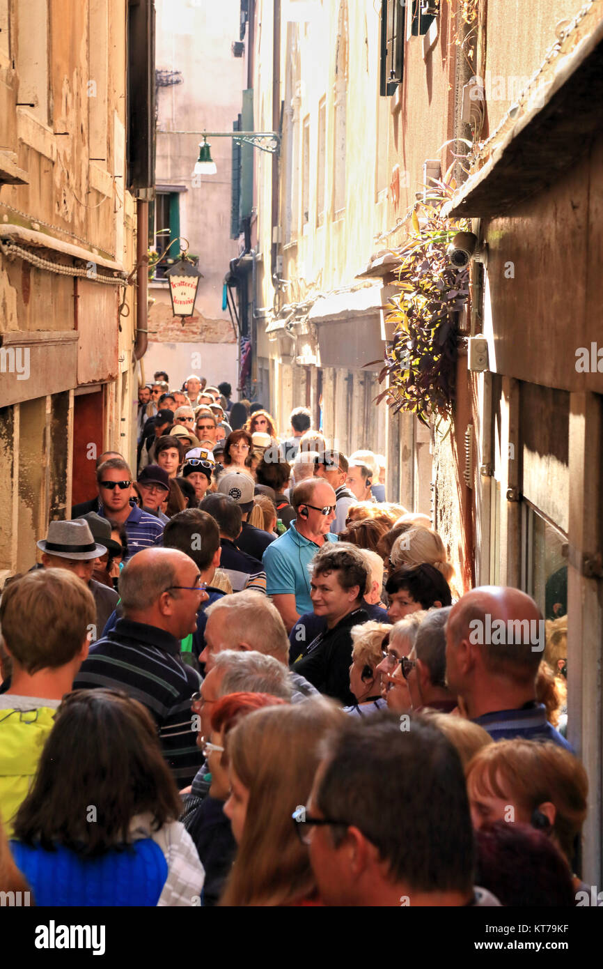 Venice tourists crowd, mass tourism, street crowded with people - Stock Image