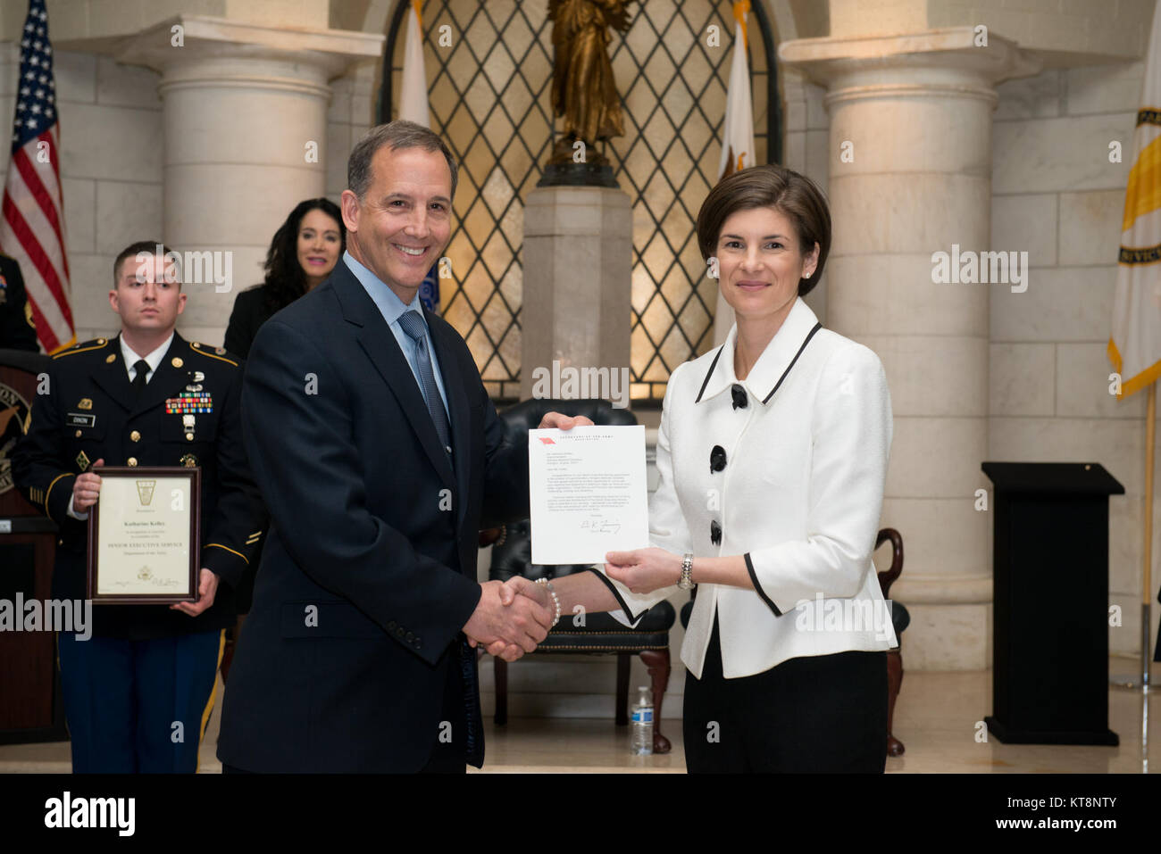 Katharine Kelley, right, superintendent, Arlington National Cemetery, receives the Secretary of the Army's letter - Stock Image