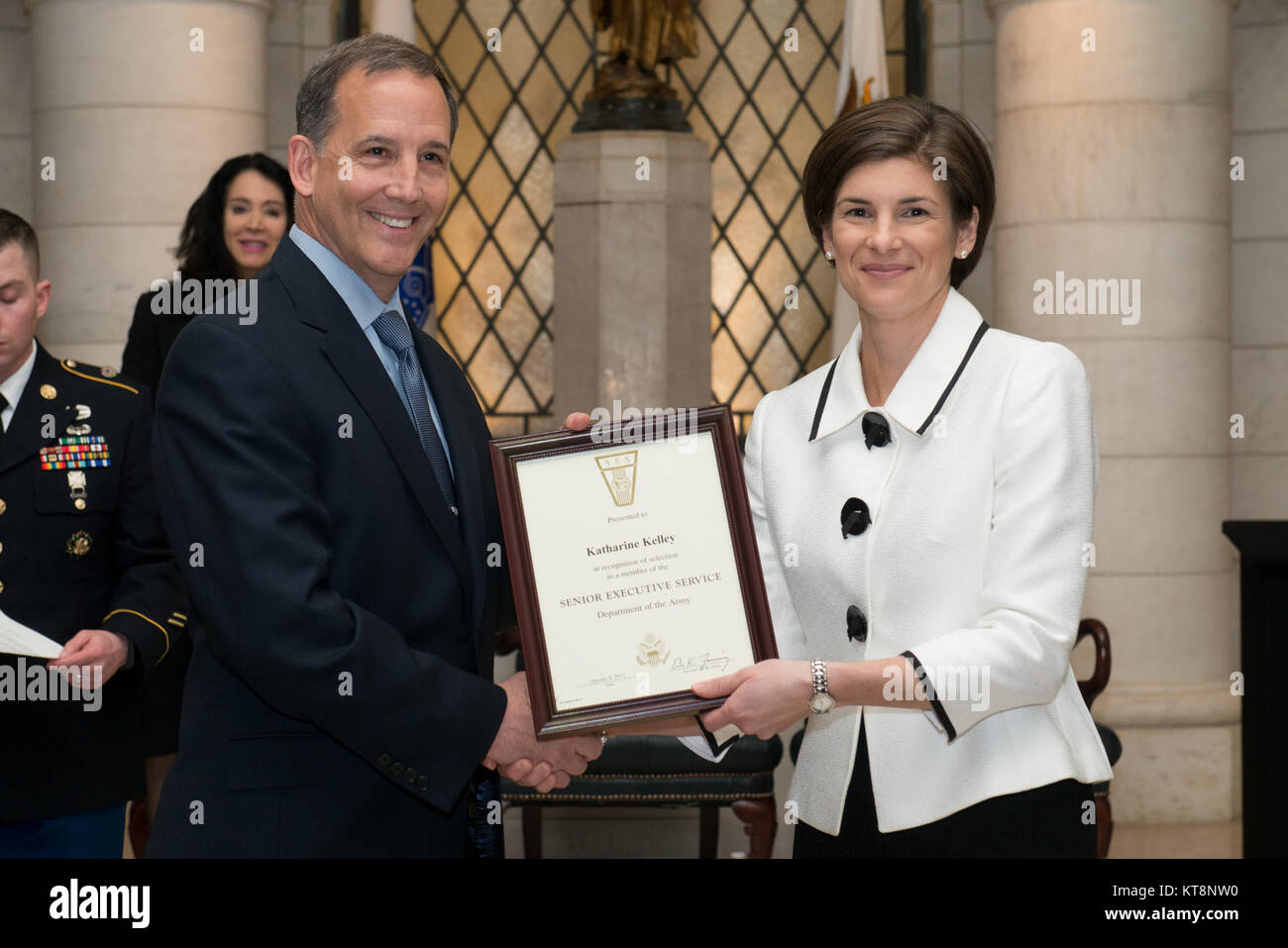 Katharine Kelley, right, superintendent, Arlington National Cemetery, receives the Senior Executive Service certificate - Stock Image