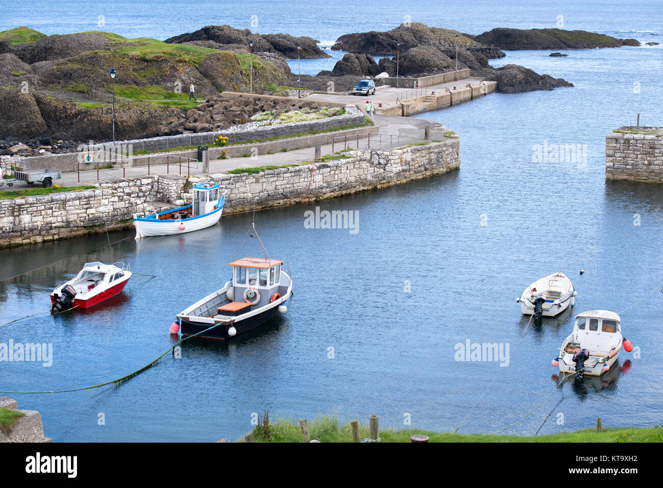 Boats in Ballintoy Harbour, County Antrim, Northern Ireland - Stock Image