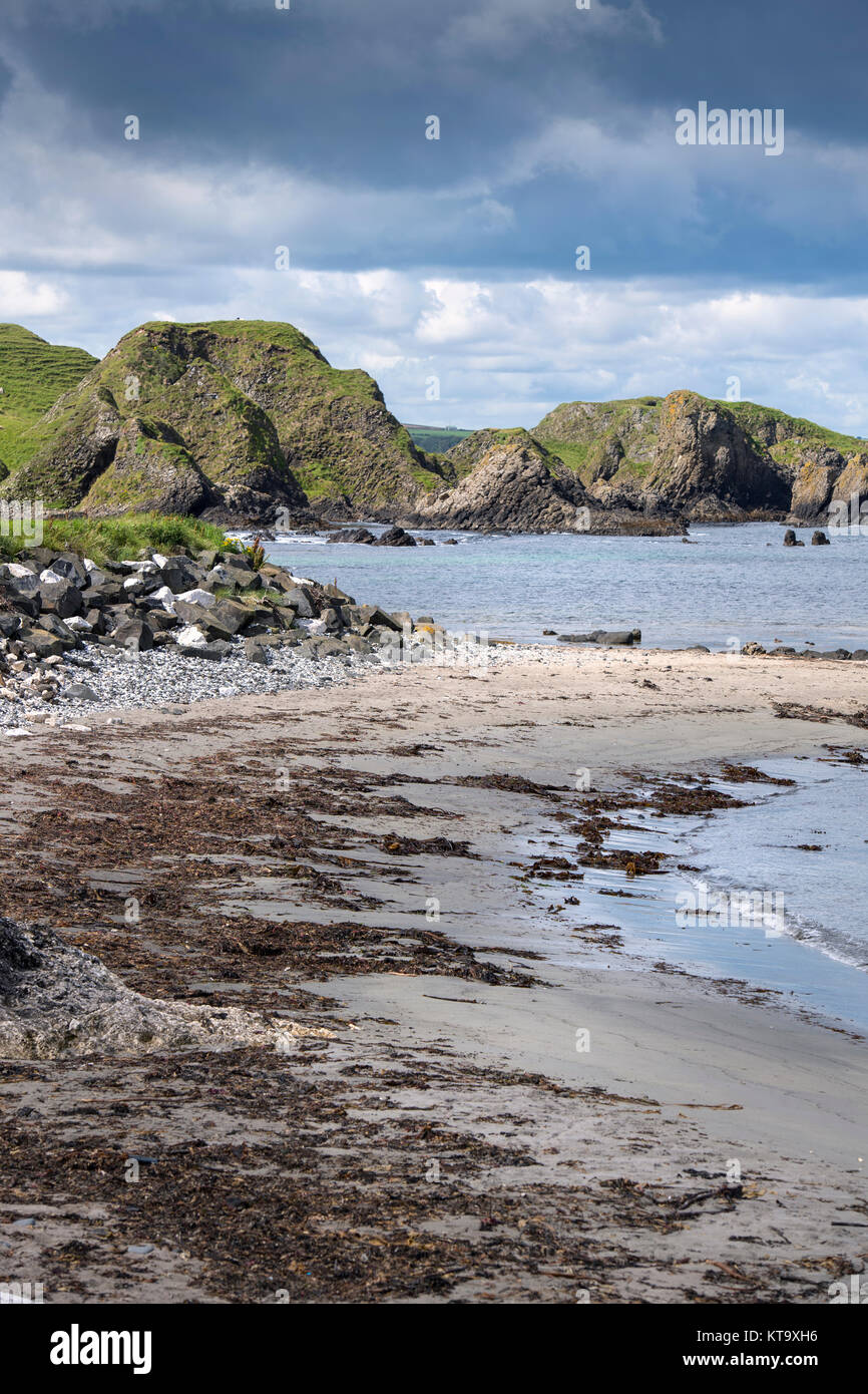 Coast around Ballintoy Harbour in County Antrim, Northern Ireland - Stock Image