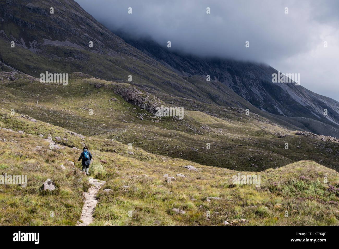 Female hiker in the Torridon hills, Wester Ross, Scotland - Stock Image