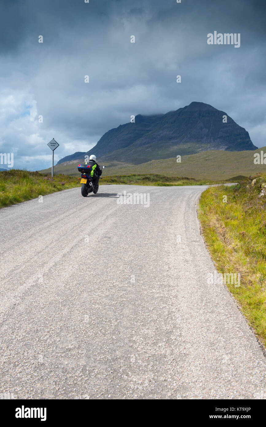Car driving along the North Coast 500 scenic route near Laide in Wester Ross, Scotland - Stock Image