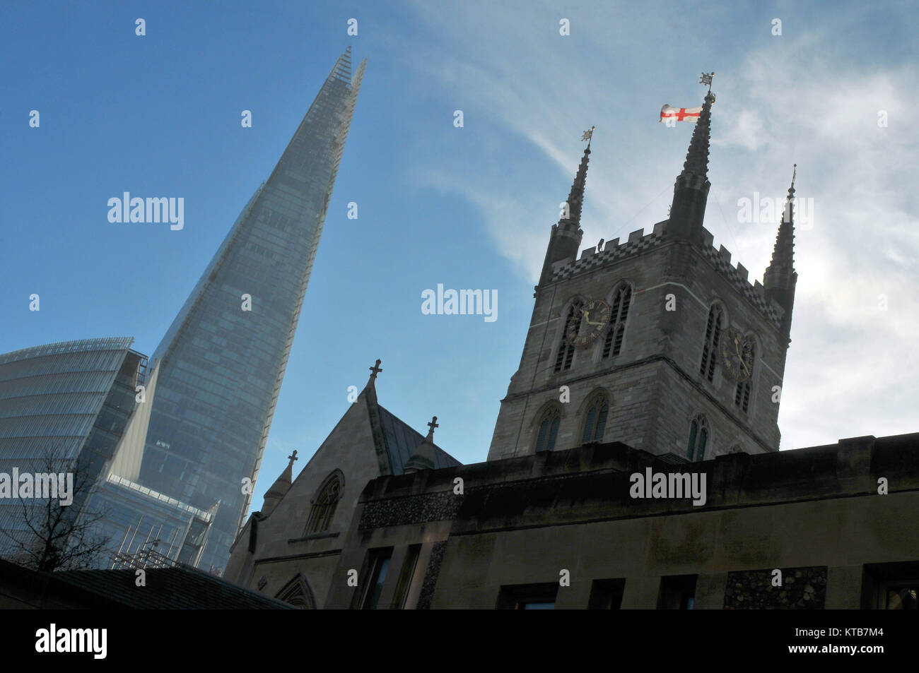 Southwark cathedral in London Bridge, Southwark , London with the shard office building in the background. contrasting - Stock Image