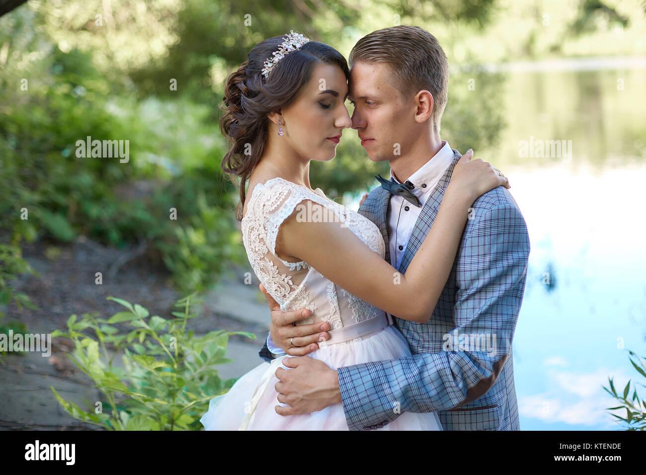 Beautiful Young Wedding Couple Outside Stock Photos ...