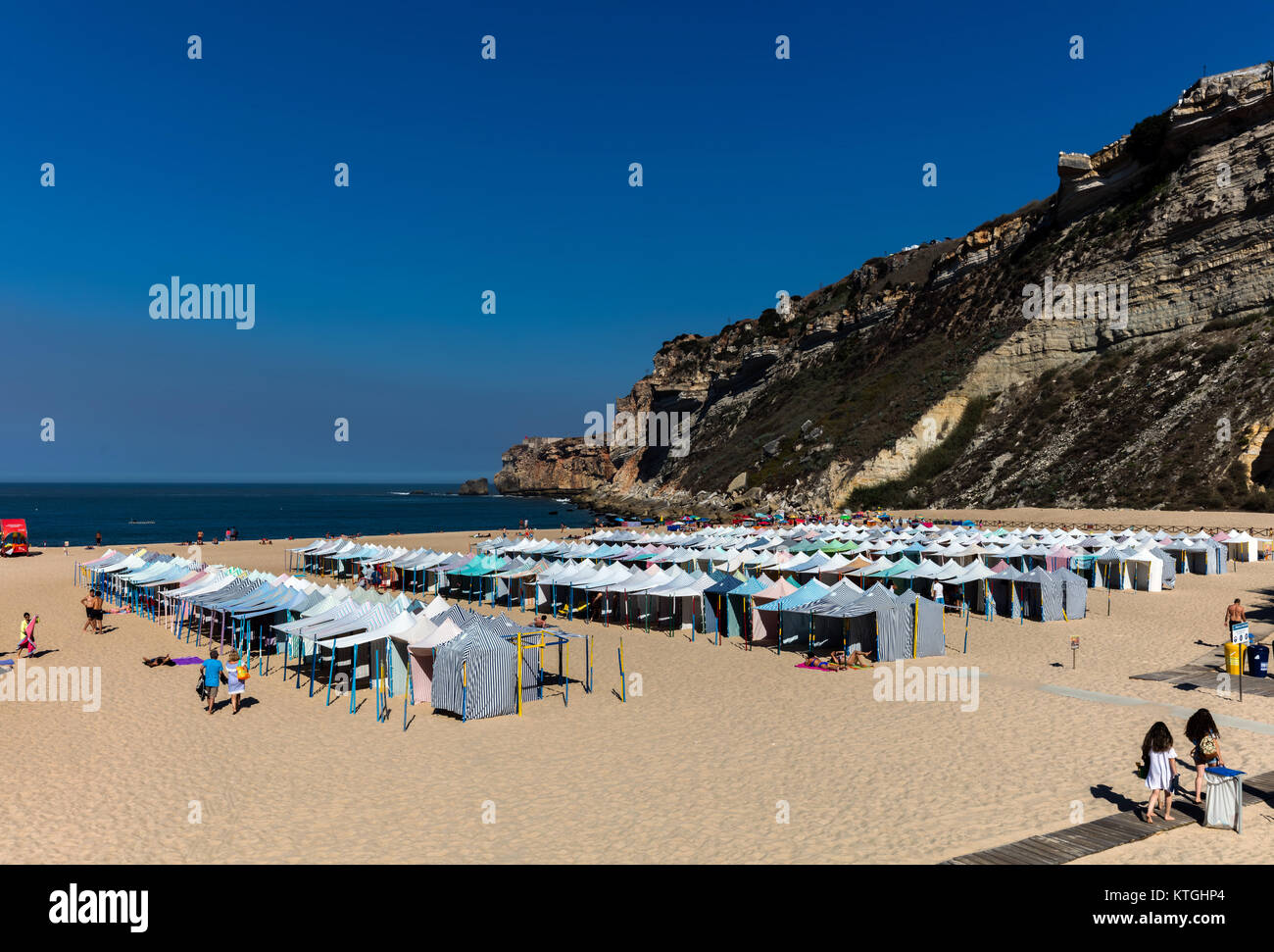 Nazare, Portugal, August 12, 2017: Praia da Nazare beach, covered with the summertime beach tents. - Stock Image