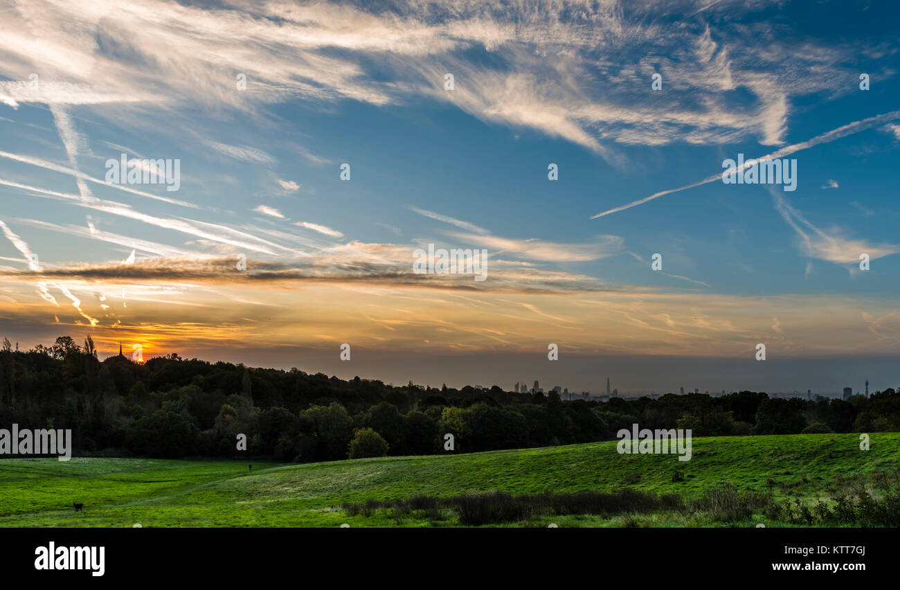 Stunning sunrise over the London skyline from Hampstead Heath, London, UK - Stock Image