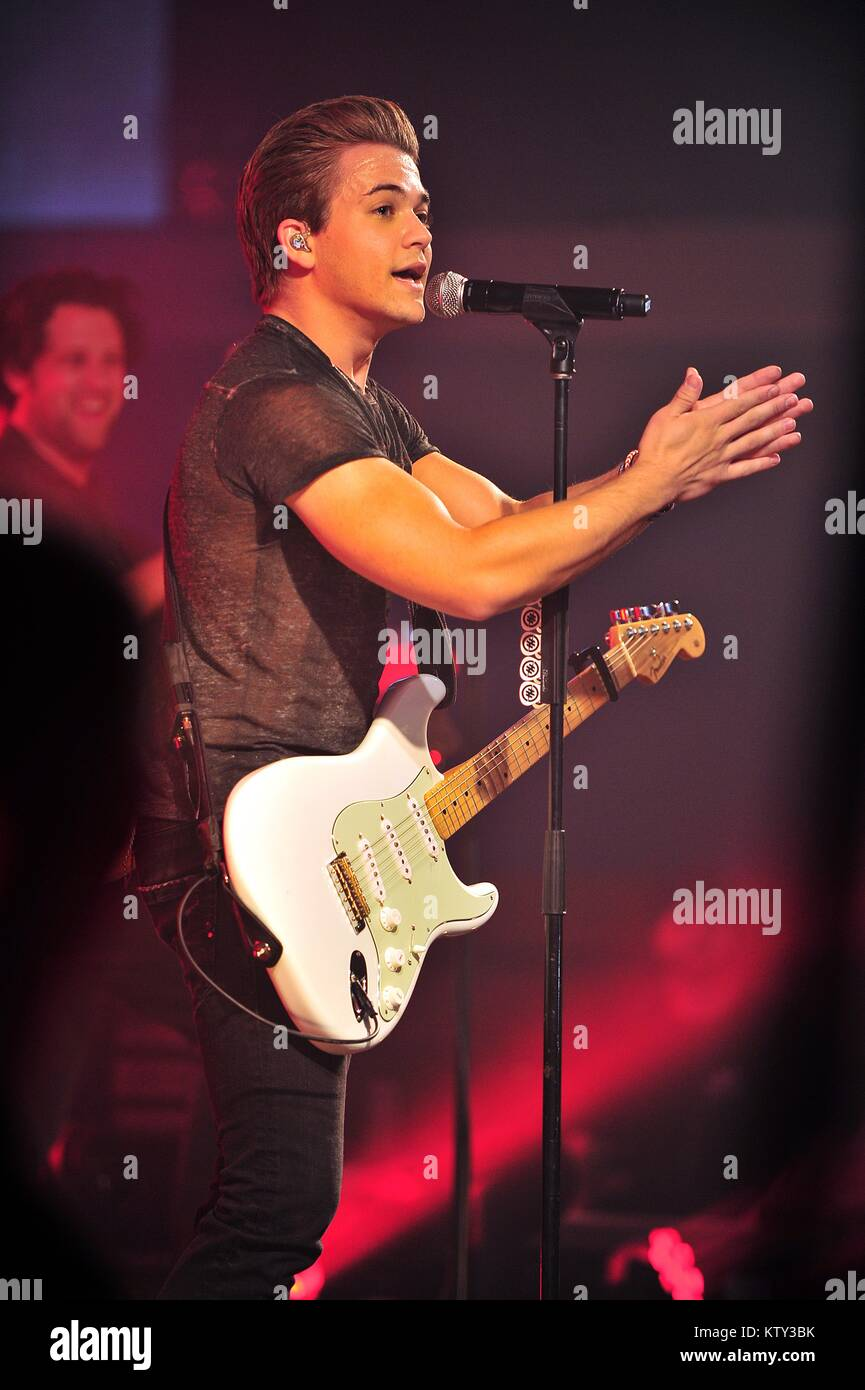 Country music singer Hunter Hayes performs for soldiers during a USO Tour concert at the Royal Air Force Mildenhall - Stock Image