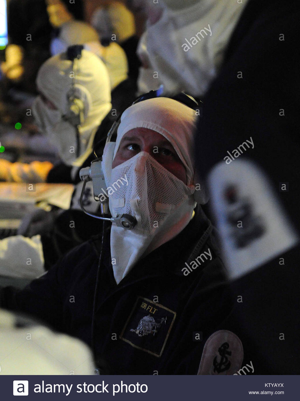 A member of HMS Montrose's Operations Room team speaks with a colleague during an exercise.  Type 23 frigate - Stock Image