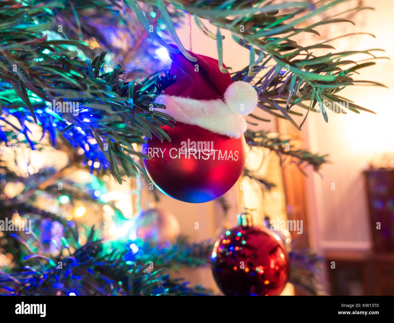 a-close-up-of-a-christmas-tree-decorated-with-baubles-and-colourful-KW13T0.jpg